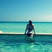 Carrie Keagan - wearing a bikini on vacation 12/24-25/12 Twitpics