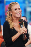 Brittany Snow shows legs in mini skirt at MTV TRL